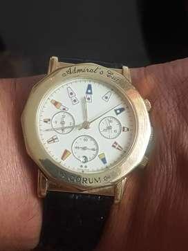 Reloj de oro cronógrafo fechero marca Corum