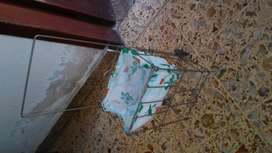 antiguo changuito de juguete de alambre