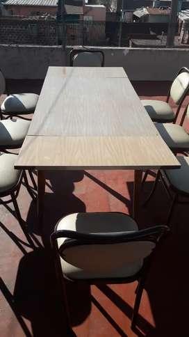 Mesa extensible y sillas de caño