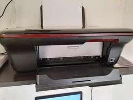 Impresora HP con sus accesorios