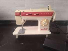Maquina de coser SINGER con discos