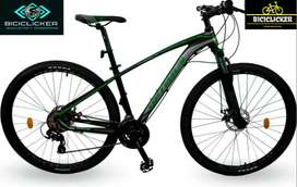 Bicicleta Optimus Aquila verde grupo Shimano biplato de 8 velocidades rin 29, freno de disco hidráulico.