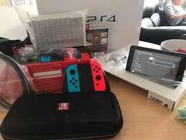Nintendo switch caja roja como  nueva varios extras