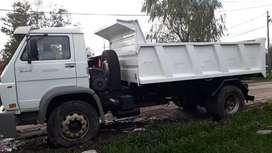 arena piedra tierra flete con camión volcador
