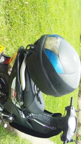 Vendo moto poco uso Bien cuidada