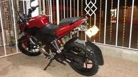 Se busca  motocicleta pulsar color rojo
