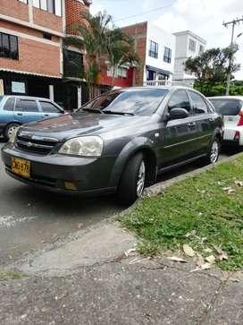 Hermoso Optra con bajo consumo de gasolina motor 1.400