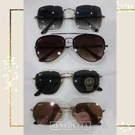 Conjuntos en animal print y lentes de sol Ray Ban