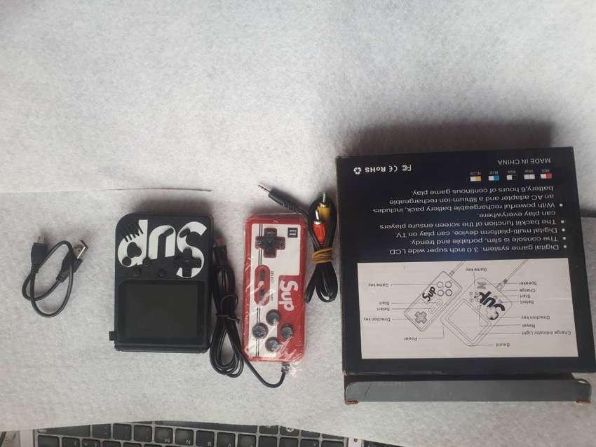 Nueva consola de juego portatil Gameboy,control para segundo jugadory 8bitscon 400juegos integrados,