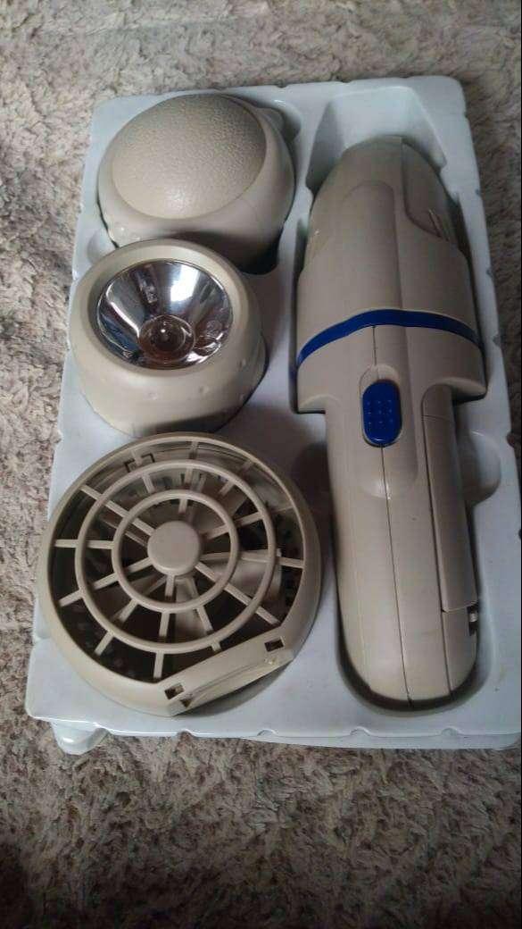 Vendo aparato multiusos contiene ventilador, aspiradora, masajeador, y linterna 0