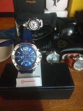 Vendo o permuto reloj TOMMY HILFIGER PRÁCTICAMENTE NUEVO multigrah ORIGINAL