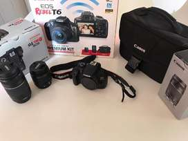 Camara Canon EOS REBEL T6 + lente Canon EF-S 18-55mm + lente EF 75-300mm + Estuche Bag 100ES + SD Sony 64 GB clase 10