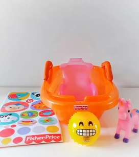 Bañera Fisher Price con cambiador, soporte y juguetes para el baño