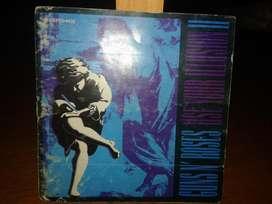 PIURA  BOOKLET DEL CD USE YOUR ILLUSION II DE LA BANDA DE ROCK GUNS N ROSES