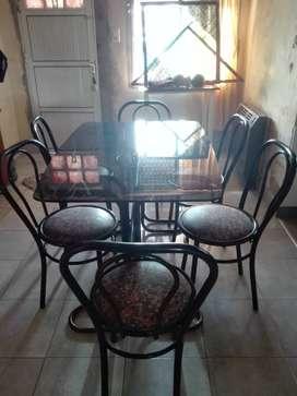Mesa de vidrio y 6 sillas