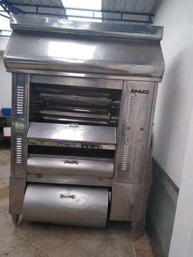 Vendo horno en acero de, carbón para 18 polllos