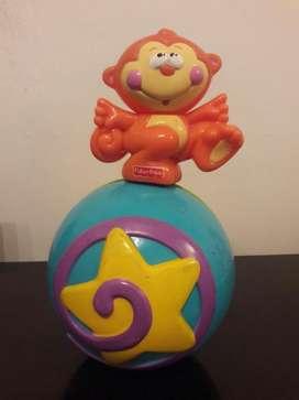 Mono pelota musical en equilibrio. Fisher Price