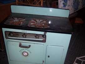 antigua cocina volcan a kerosene año 1950de coleccion