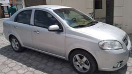 aveo emotion 2013 vendo  o cambio