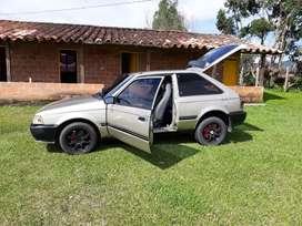 Vencambio excelente mazda 323 coupe