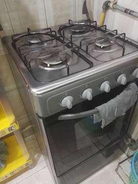 Estufa de 4 puestos y horno funcional, marca centrales