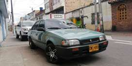 Mazda 323 NE perfecto estado