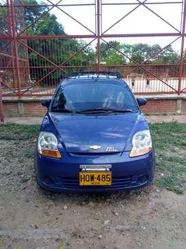 Chevrolet Spark, modelo 2014, color azul.