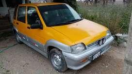 Tico DAEWOO color amarillo plateado