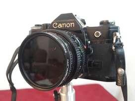 Camara Canon AE1 reflex con lente 52 mm f 1:1.4