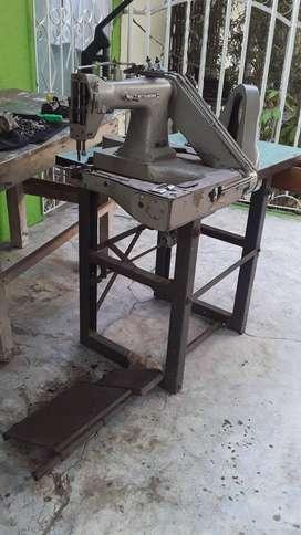 Maquina de codo para coser