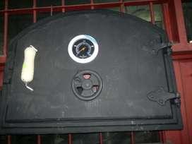 Puerta de fundicion para horno de barro