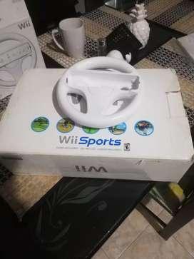 Vendo consola wii sports con timon y juegos
