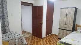 Habitacion Amoblada con área de kitchenen, lavadero y baño privado.