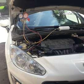 Carga y recarga de gas aire acondicionado automotor