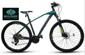 Bicicleta Optimus Tucana, grupo shimano Deore de 10 velocidades, bloqueo al hombro, rin 29, freno de disco hidráulico.