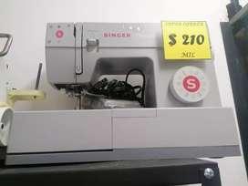 Maquina de coser familiar marca singer