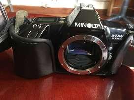 Camara de rollo con lente zoom y flash