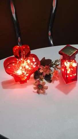 Perfumeros en vidrio con luz LED.