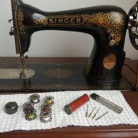 Maquina Singer antigua, siete gabetas.