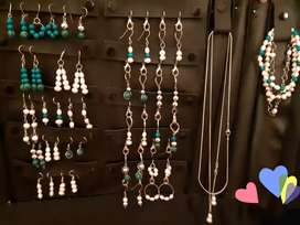 Vendo paño completo de joyas artesanales de Acero y Plata con con Perla Natural y Malaquita. Ideal emprendedores