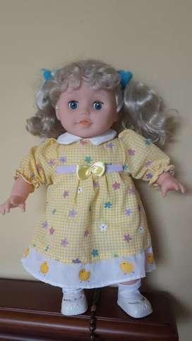 Muñeca que canta los pollitos