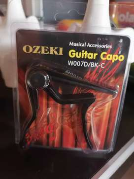 Capo negro para guitarra