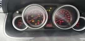 Por necesidad vendo mi Mazda CX9