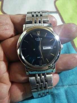 Reloj citizen para hombre en acero doble calendario
