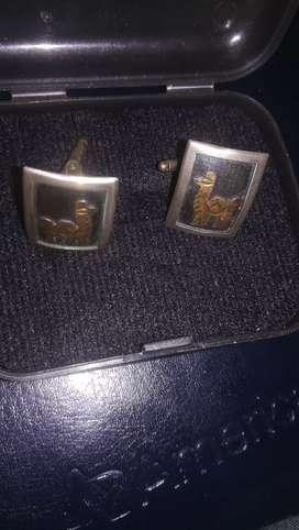 Gemelos antiguos oro y plata
