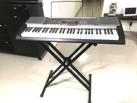 Piano Casio de 61 teclas
