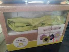 Musical de cuna de niña color lila marca carters seminuevo es genial, no necesita baterías, marca carters.