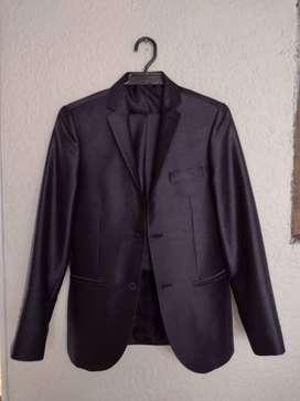 Se vende traje de paño satinado en perfecto estado -  unica postura