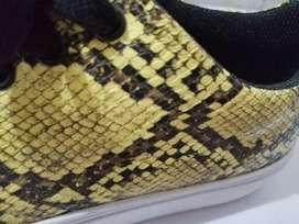 Tennis textura serpiente amarillos