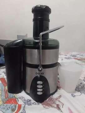 Extractor de jugos marca Óscar